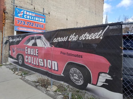 Eagle Collision secured lot across the street promoting our automobile repair services.
