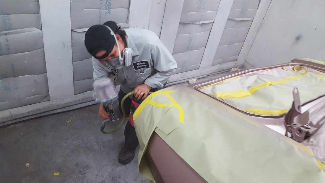 our technician doing bumper work on a car including replacing bumper and repainting bumper of car.