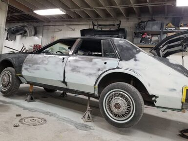 A Cadillac sedan getting complete paint job
